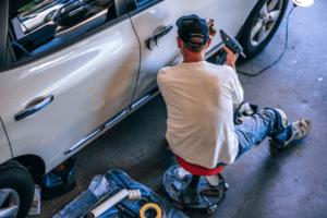 a mechanic working on a car